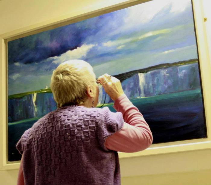 lady looking at painting